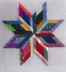 scrap bag star needlepoint ornament stitched by janet m. perry