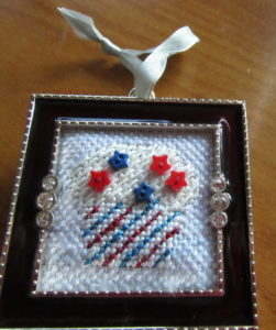 finishd Danji mini cupcake needlepoint in Studio Decor ornament frame